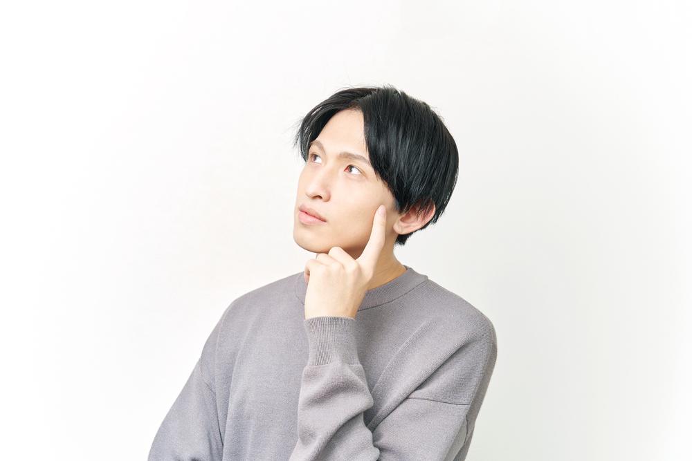 Asian,Man,Thinking,On,White