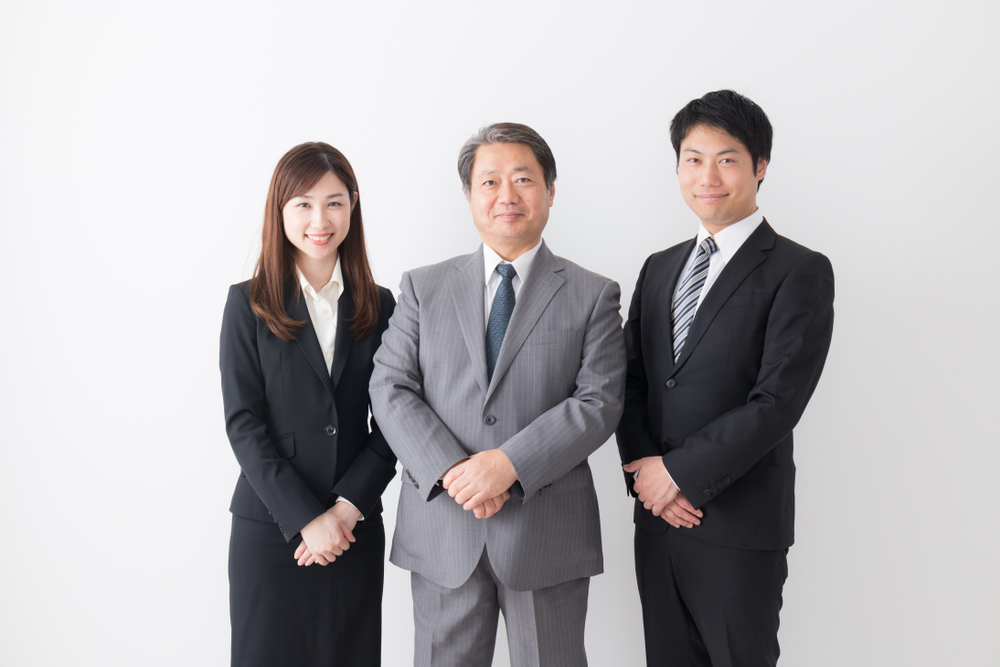 Asian,Businessmen,And,Businesswoman