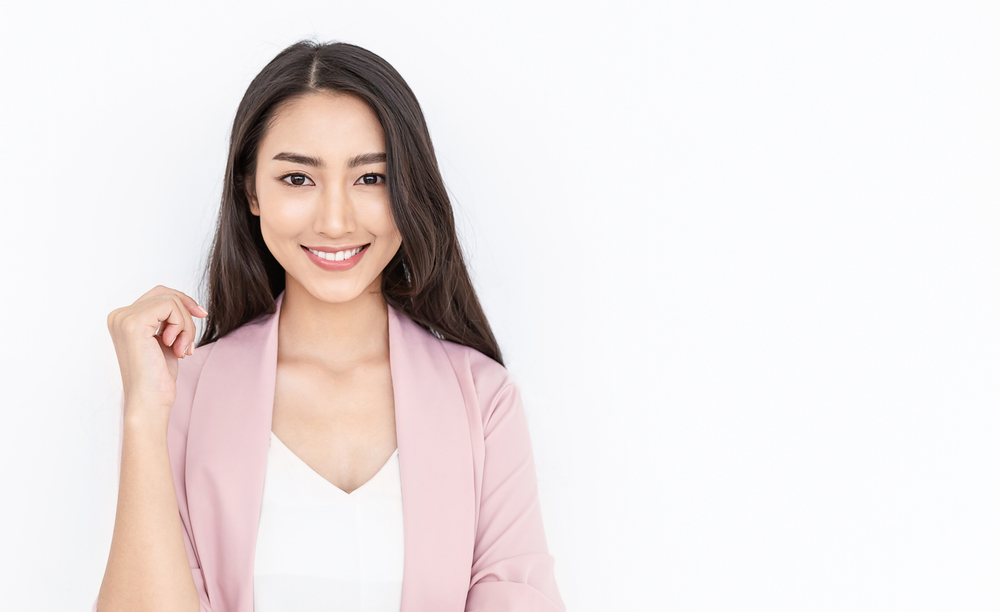 Portrait,Of,Smiling,Confident,Asian,Business,Woman,In,Pink,Suit