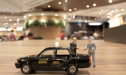 A,Small,Business,Figure,With,Japan,Taxi